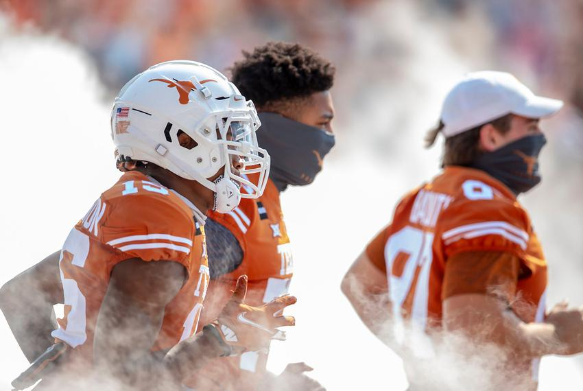 The Texas Longhorns take the field against TCU Horned Frogs in an NCAA college football game at Darrell K Royal-Texas Memori…