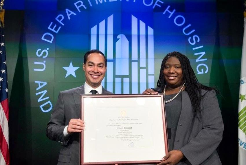 Senior Adviser Maya Rupert and Housing Secretary Julian Castro.