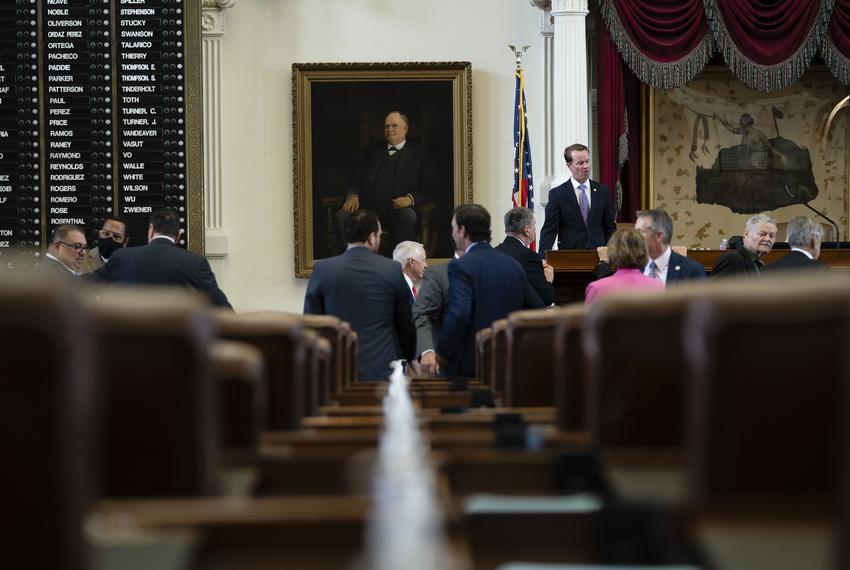 Legislators talk amongst themselves on the House floor on July 19, 2021.