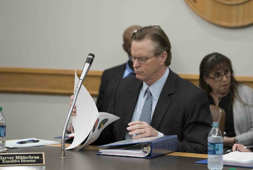 Executive Director Harvey Hildebran gathers his papers to leave the room shortly after being fired by the Texas Facilities Commission board on Jan. 25, 2018.
