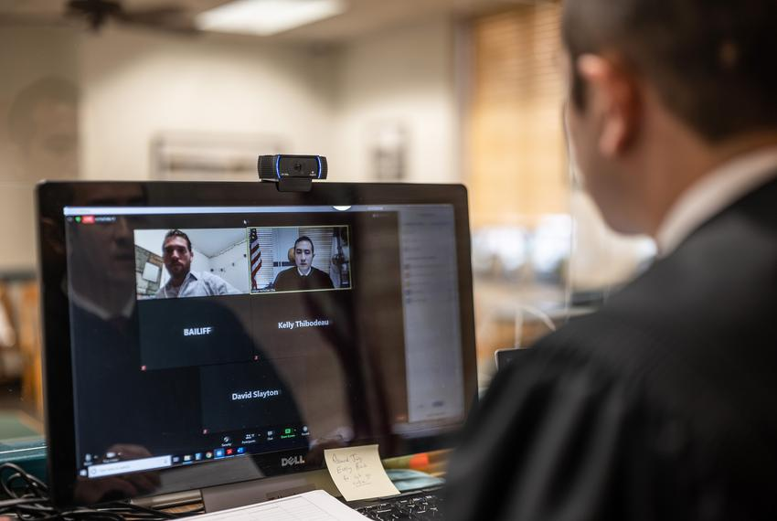 Travis County Judge Nicholas Chu prepares for the nation's first virtual criminal trial in a traffic case in August 2020.