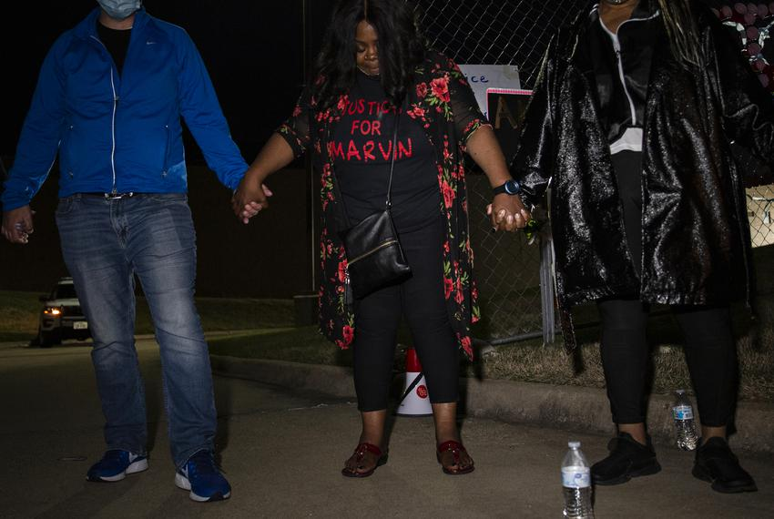 Marvin Scott III's mother, LaSandra Scott, prays at the end of a demonstration outside of the Collin County Jail. People gat…