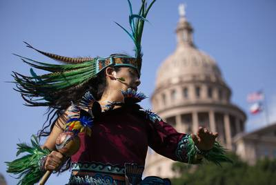 San Antonio resident Rosie Torres perform a Danza Mexica prayer offering on the Capitol South Lawn on May 22, 2019 as part of the Society of Native Nations' first annual Indigenize the Texas Capitol Day.