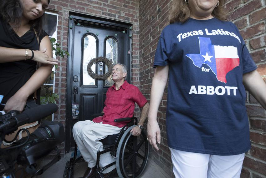 Gov. Greg Abbott and wife Cecilia leave the front door of a Bentsen Heights residence where no one was home during a block w…