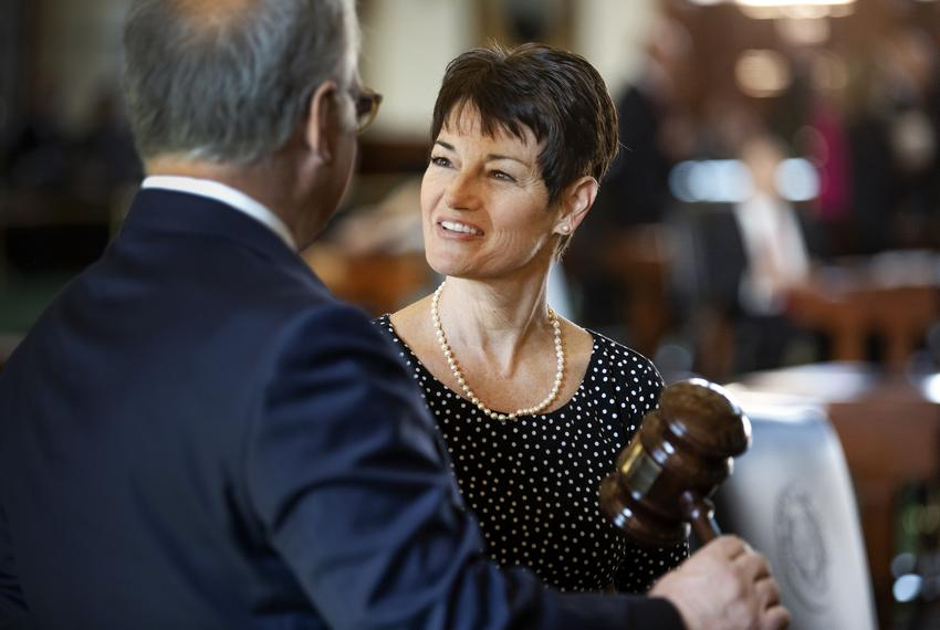 State Sen. Donna Campbell, R-New Braufels, speaks with State Sen. Kirk Watson, D-Austin, shortly after he received the gavel…