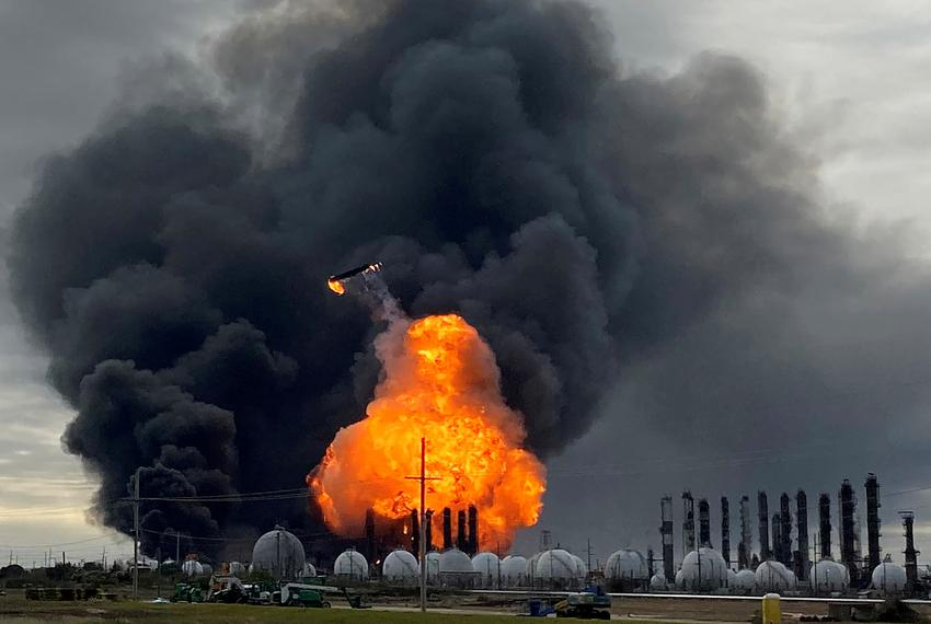 A process tower flies through air after exploding at the TPC Group Petrochemical Plant in Port Neches. An earlier massive ...