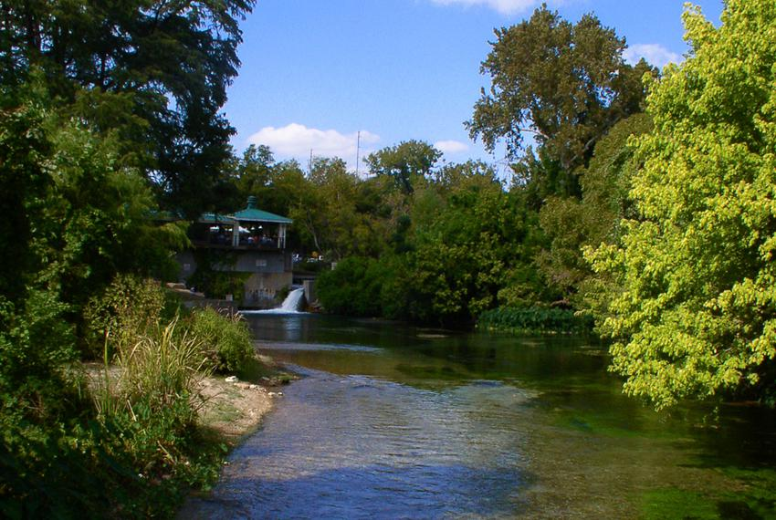 A view downstream from the headwaters of the San Marcos River. Water from the Edwards Aquifer flows from San Marcos Spring...