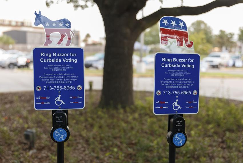 Curbside voting Signs with buzzers outside the Metropolitan Multi-services in Houston.