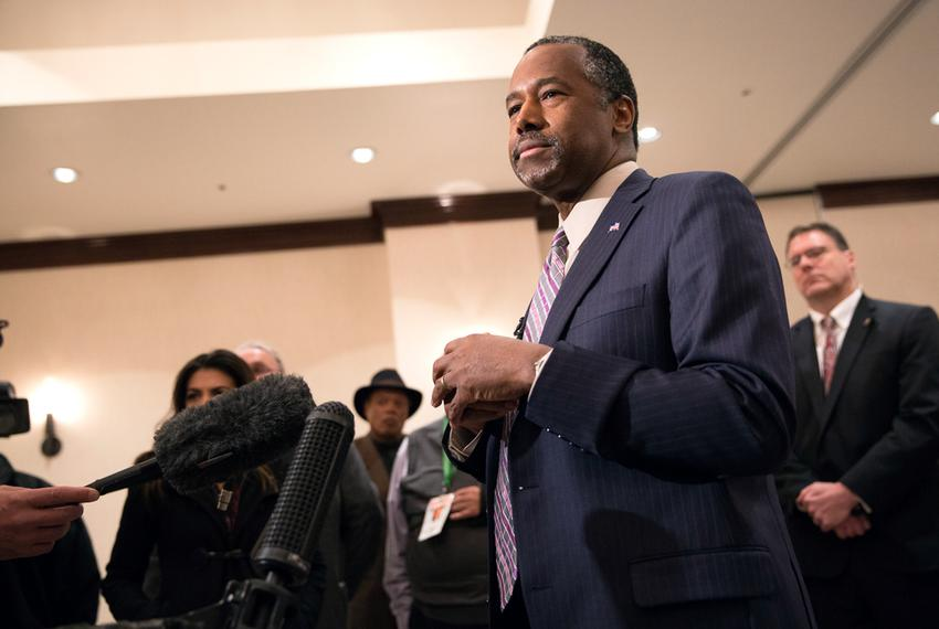 Ben Carson, neurosurgeon and Republican presidential hopeful, speaks with the press after a campaign event in Irving on Fe...