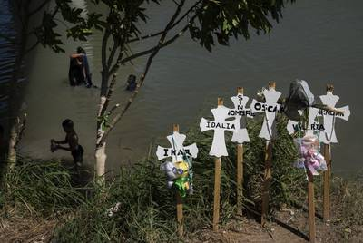 Memorial crosses left on the banks of the Rio Grande in honor of those who lost their lives trying to cross to the U.S. this year in Matamoros, Mexico on Sunday, Oct. 13, 2019. Verónica G. Cárdenas for The Texas Tribune