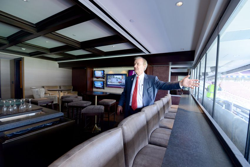Texas A&M Chancellor John Sharp points to the view of Kyle Field inside one of the Founder suites on Thursday during a media tour of the newly built West side.