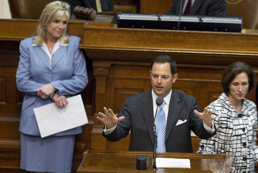 State Rep. Rafael Anchia, D-Dallas, offers an amendment on SB14 voter ID legislation as House sponsor State Rep. Patricia Harless, R-Spring, (l) listens on March 23, 2011.