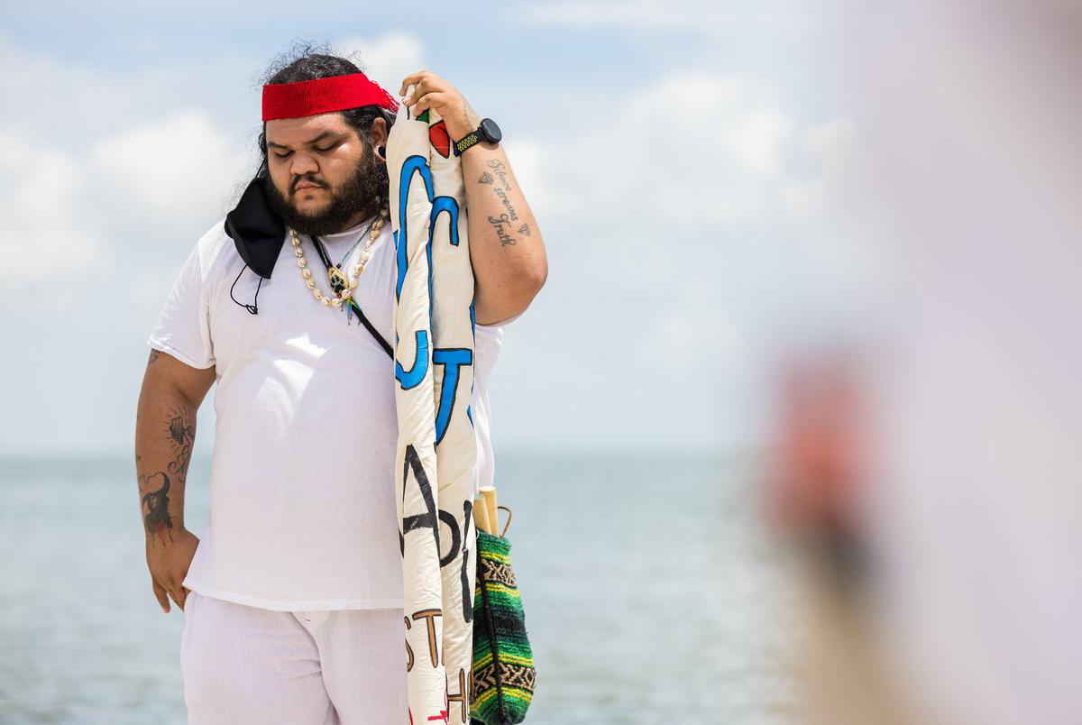 Wally Flores, of the Indigenous People of the Coastal Bend, participates in a prayer ceremony at McGee Beach in Corpus Christi in protest of the expansion of the Moda Ingleside Energy Center on Aug. 28, 2021.