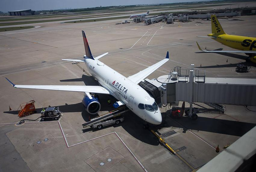 Delta Air Lines' new Airbus A220 jet rests between flights at Dallas-Fort Worth International Airport in April of 2019.