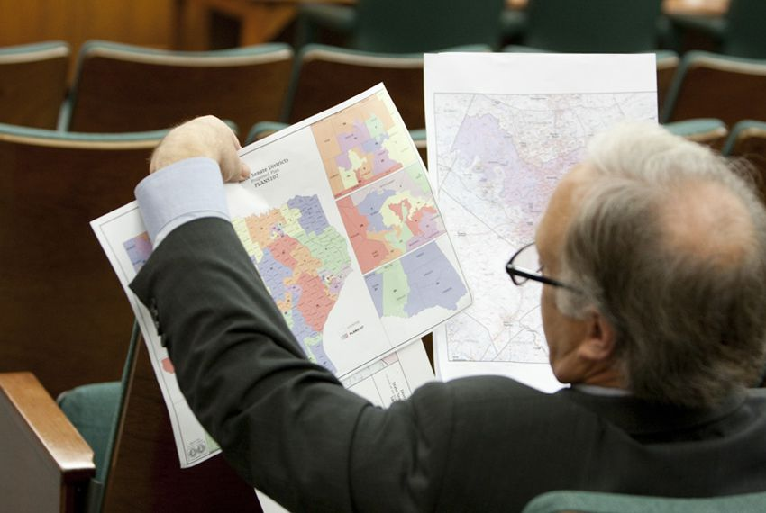 State Sen. Kirk Watson, D-Austin, looked at redistricting maps during a Senate hearing in 2011.