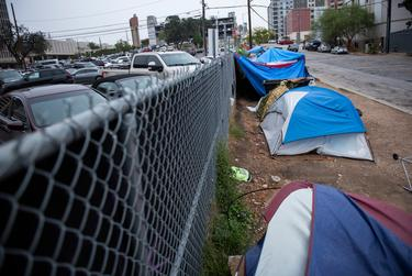 Tents found in front of the Austin Resource Center for the Homeless  (ARCH) are adjacent to parking lots and the rest of downtown Austin, as seen on Oct. 29, 2019.