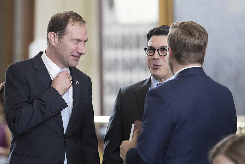 Sen. Charles Schwertner, R-Georgetown, visits with State Rep. Chris Paddie, R-Marshall, after Senate passage of HB 100, wh...