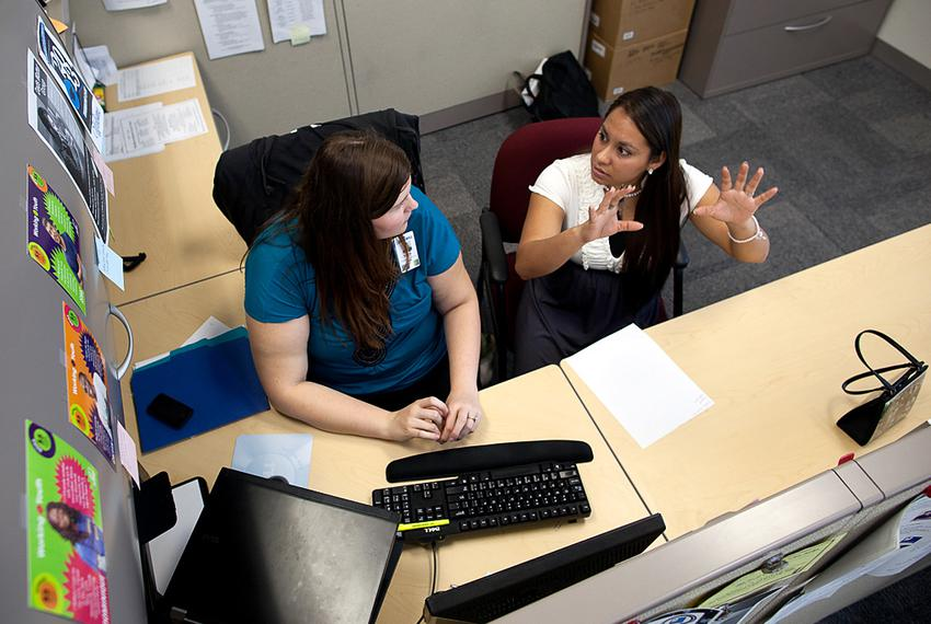 Rachel Bristow, a caseworker for Goodwill's GED program, assists 22-year-old Anita Rodriguez, who received her GED in August…