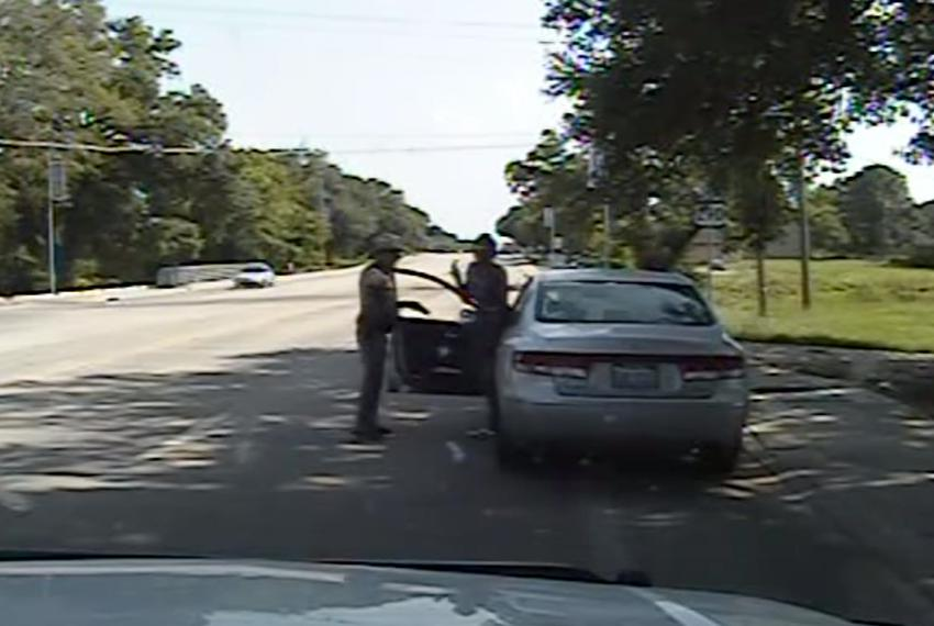 Screenshot from Department of Public Safety dash cam video shows Sandra Bland as she exits her car after DPS officer Brian E…