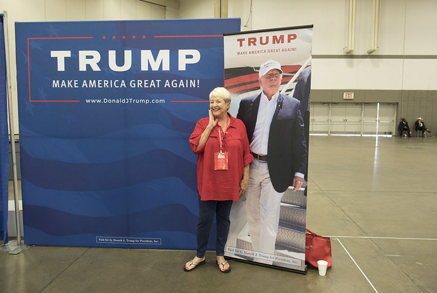Linda Eden of Denton County poses with Donald Trump poster while attending the trade show at the Republican Party of Texas convention on May 13, 2016.