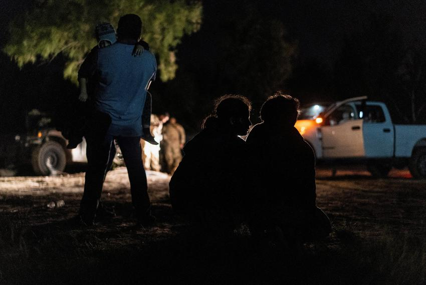 Asylum-seeking migrant families rest at the riverbank as they wait to be escorted by the U.S. Border Patrol after crossing t…