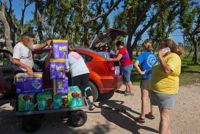 Rockport Relief Camp volunteers load boxes of diapers for a daycare center that cares for children of families affected by Hurricane Harvey on Friday, July 13, 2018. Samantha McCrary opened up her land in Rockport as a refugee camp after Harvey hit the area. It's now a distribution center for people who will still need supplies and food.