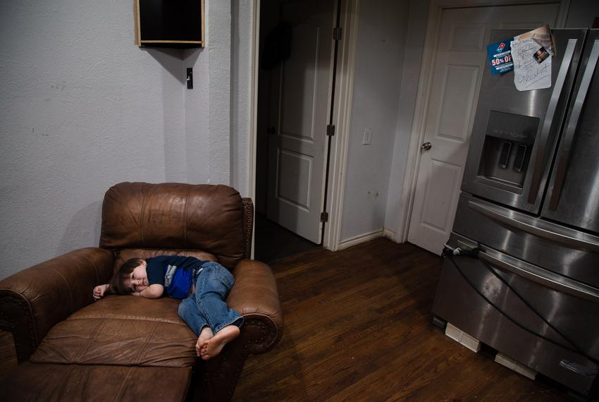 Noah Proctor lays on an arm chair in his home in central Houston on April 11, 2021.