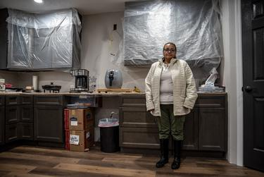 Christine Lopez in her kitchen in Friendswood on Tuesday, Dec. 10, 2019. The home was severely damaged by flood water as a result of Hurricane Harvey in 2017.