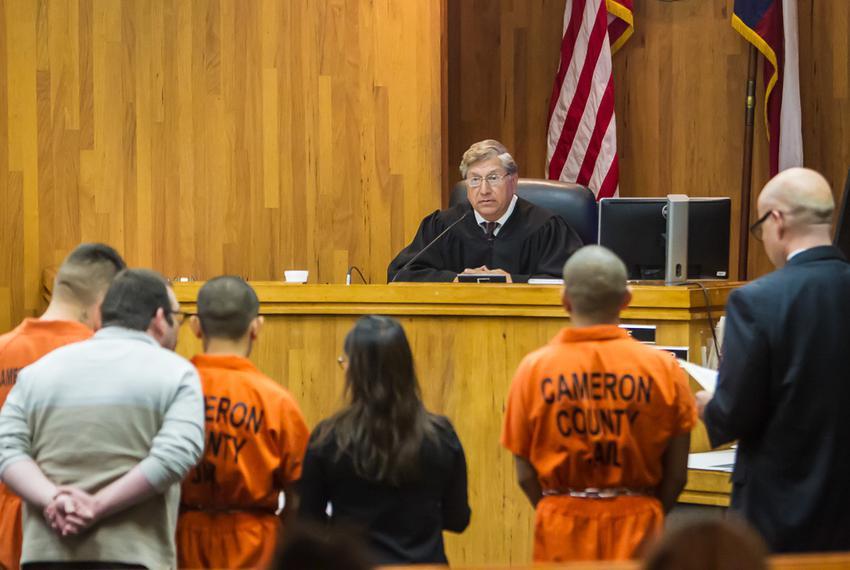 Suspects (l-r) Aaron Rodriguez Medellin, Eduardo Luna Rodriguez and Joel Luna Rodriguez stand before District 107 Judge Benj…