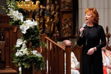 """Reba McEntire sings """"The Lord's Prayer"""" during a funeral service for former President George H.W. Bush at St. Martin's Episcopal Church Thursday, Dec. 6, 2018, in Houston. David J. Phillip/Pool via REUTERS"""