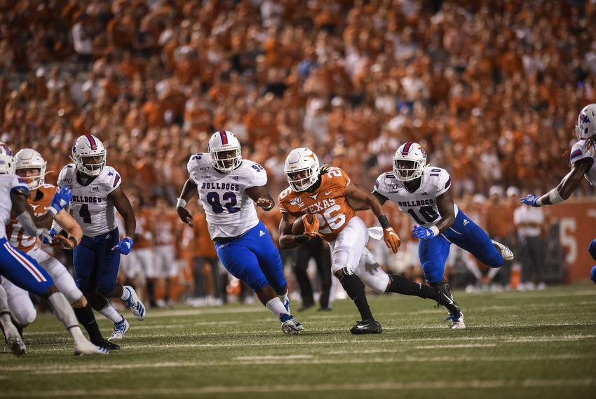 Texas running back Keaontay Ingram runs the ball against Louisiana Tech at a game in Austin on Aug. 31, 2019.