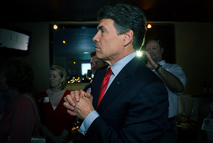 Gov. Rick Perry on May 29, 2012, watching television returns after speaking at the party for Charles Schwertner's victory ...