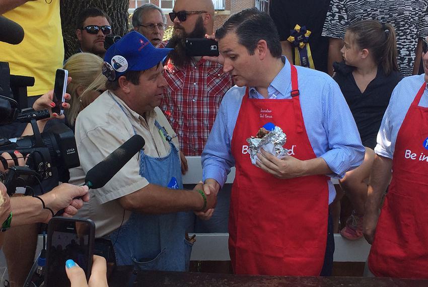 U.S. Sen. Ted Cruz, R-Texas, eats a pork chop sandwich Friday at the Iowa State Fair. Cruz fielded questions throughout his …