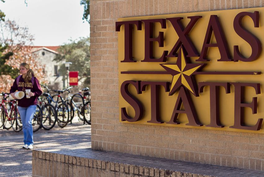 "Students walk through ""The Quad"" at Texas State University."
