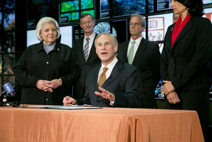 Gov. Greg Abbott signs several higher education related bills into law on June 4, 2015. He also praised state Sen. Judith ...