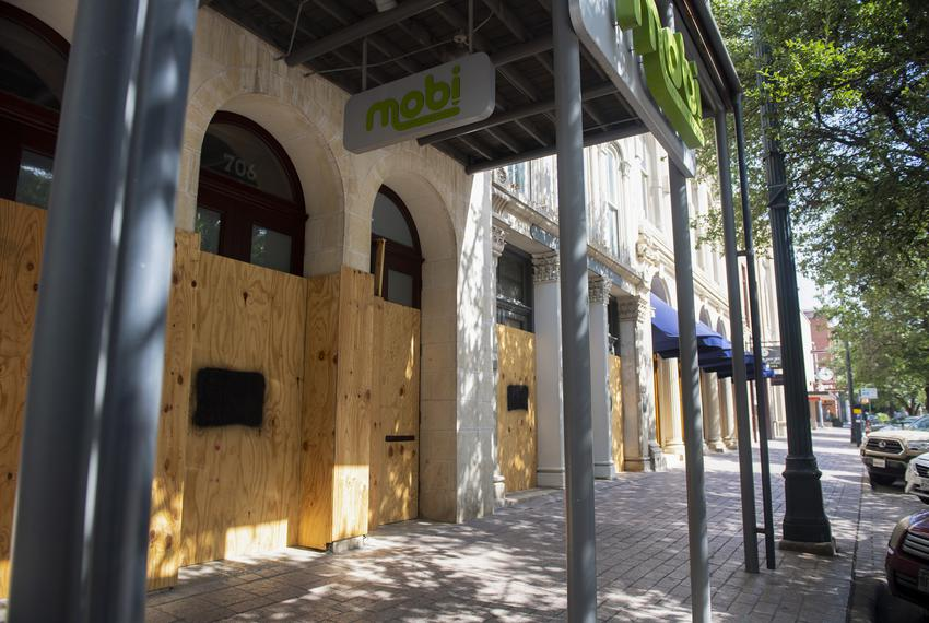 Mobi, a business located on Congress Avenue in Austin, is boarded up. July 17, 2020.