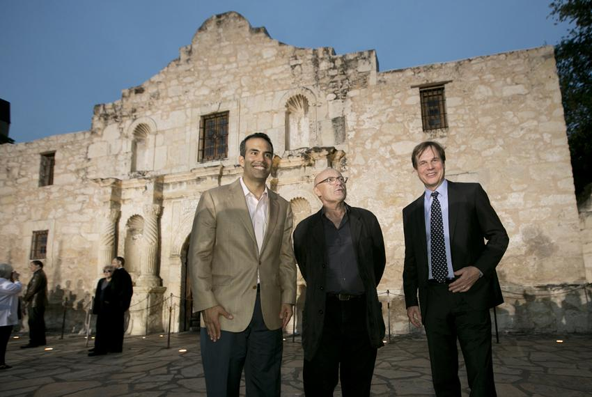 Texas Land Commissioner George P. Bush poses in front of Alamo with singer Phil Collins and actor Bill Paxton following a pr…