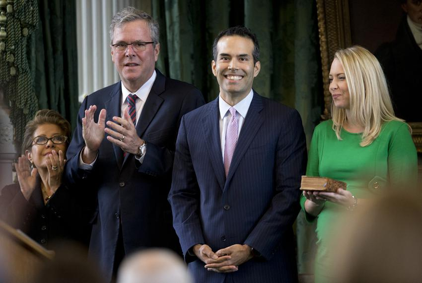 George P. Bush is all smiles as his mother, Columba, father, Jeb, and wife, Amanda, applaud during Bush's swearing in as T...