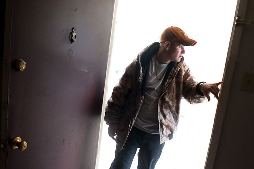 Cameron Maedgen enters his apartment in San Angelo. Maedgen, an autistic, brain-damaged, 19-year-old, is ineligible for state services because his IQ is too high — but too low-functioning to live without assistance.