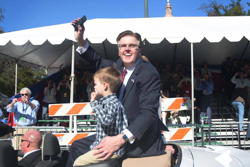 Patrick waves to onlookers from the south entrance to the Capitol grounds.