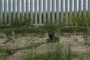 A close-up of erosion at the base of the privately-funded border wall in Mission.