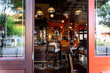 Patrons enjoy drinks at B.D. Riley's Irish Pub in Austin on May 22, 2020.