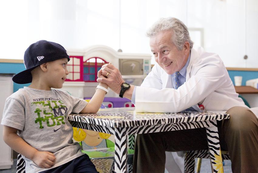 Pediatric oncologist Dr. Kenneth McClain playfully arm-wrestles with patient Isiah Trujillo on Monday, April 25, 2011, at Te…