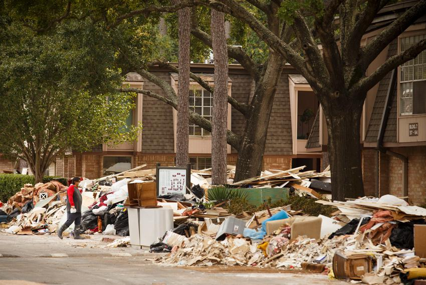 Debris from Hurricane Harvey is piled high at the Pines Condominiums near the Buffalo Bayou in the Memorial area of Houston …