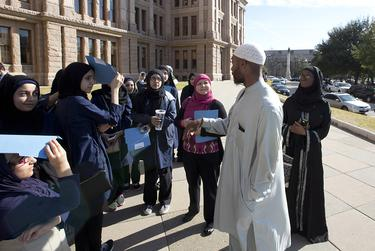 A group of students gather by the south entrance of the Capitol on Texas Muslim Capitol Day on Jan. 29, 2015.