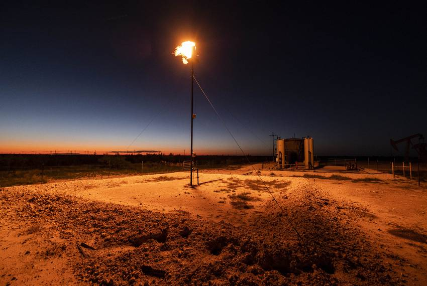 A natural gas flare burns bright at an oil well northeast of Andrews.