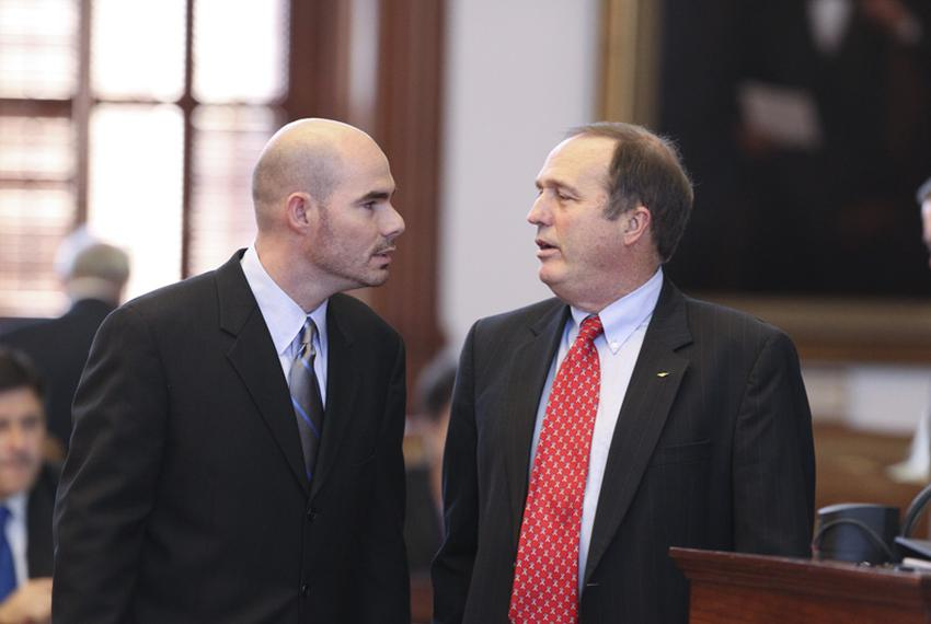 State Rep. Dennis Bonnen (L), R-Angleton, has words with state Rep. Rob Eissler, R-The Woodlands, during debate on Eissler's…