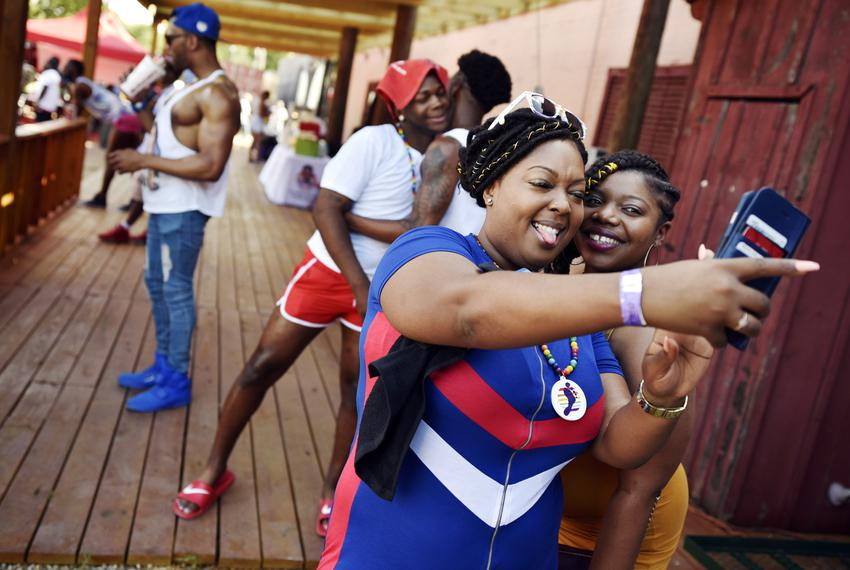 Ashley Williams, left, and Tangela Lewis, 25, take a selfie at the Dallas Southern Pride Juneteenth Festival at the Longhorn…