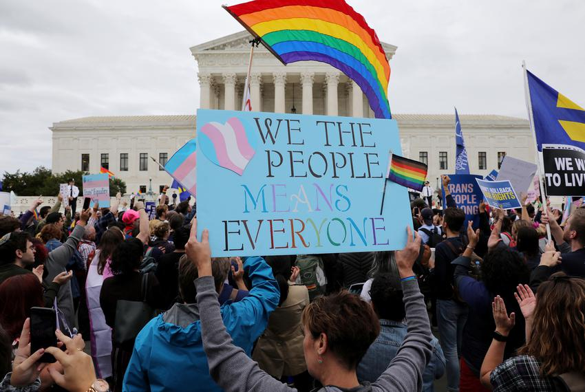 LGBTQ activists and supporters hold a rally outside the U.S. Supreme in Washington on October 8, 2019.