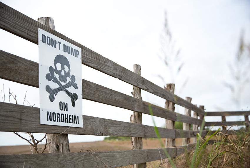 A sign protesting a proposed drilling waste dump near the South Texas town of Nordheim is shown in 2014. The Texas Railroad …